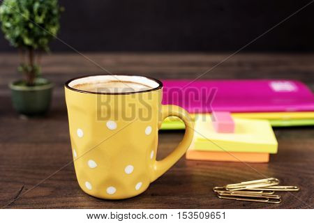Yellow Cup Of Coffee With White Dots. Pretty Pink Office Accessories - Notebooks, Gold Pins, Sticker