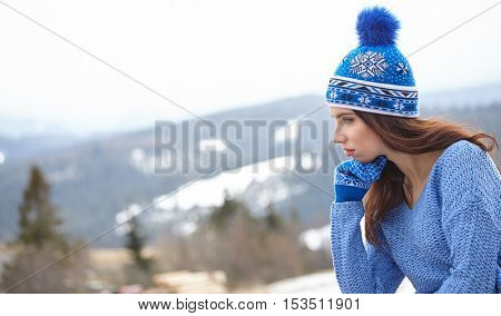 happy young woman in ski cothes outdoors.