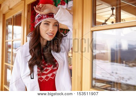 winter, leisure, sport and people concept - happy young woman in ski cothes outdoors