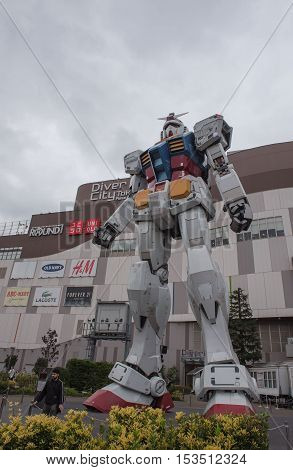 TOKYO, JAPAN - OCTOBER 11 ,2016 :  Full size Gundam robot replica in Odaiba,Tokyo. The sculpture is tall 18m The sculpture of famous anime franchise.