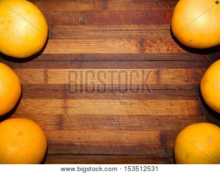 Good as background. Yellow ripe juicy tangerines on a wooden chopping board