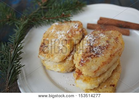 , French toast with cinnamon on wooden background