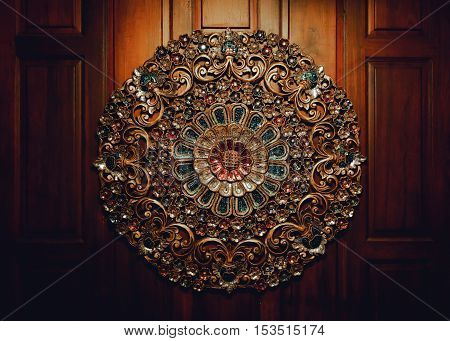 the beautiful antique circle shape of art object decorate on wooden wall background