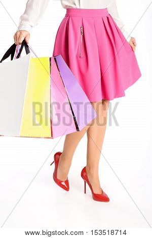 people, sale, black friday concept - woman with shopping bags isolated on white background