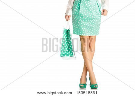 people, sale, black friday concept -  woman in green skirt with shopping bag isolated on white background