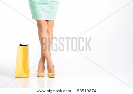 people, sale, black friday concept -  woman in green skirt with shopping bag