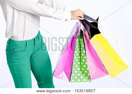 people, sale, black friday concept -  woman in green pants with shopping bag