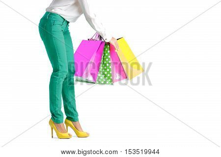 people, sale, black friday concept -  woman in green pants with shopping bag isolated on white background