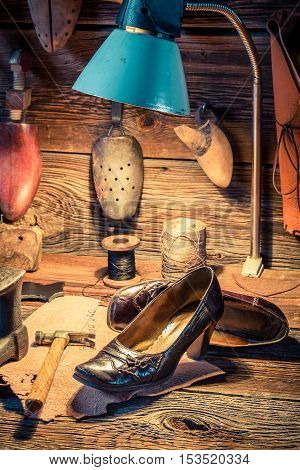 Shoemaker Workshop With Tools, Leather And Shoes