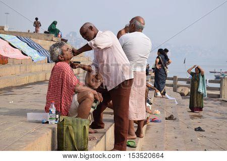 VARANASI, UTTAR PRADESH, INDIA - FEBRUARY 17, 2016 - Unidentified indian people doing morning activities on the ghats of Varanasi, the spiritual capital of India
