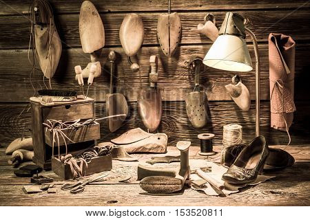 Cobbler Workshop With Tools, Shoes And Laces