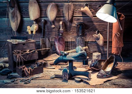 Vintage Shoemaker Workshop With Shoes, Laces And Tools