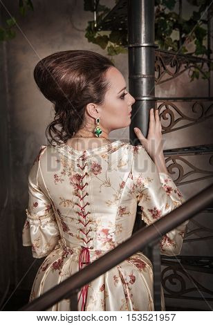 Beautiful Woman In Historic Medieval Dress. Back Pose