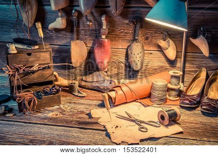 Vintage Cobbler Workshop With Tools, Shoes And Leather