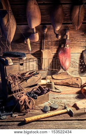 Vintage Cobbler Workshop With Tools, Leather And Shoes