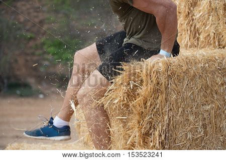 Runner to overcome obstacles and over straw bales