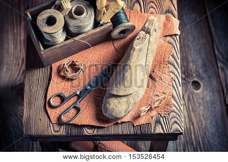 Small Cobbler Workshop With Tools, Leather And Shoes