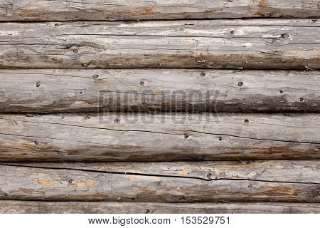 Background of a wall fragment of the old logs.