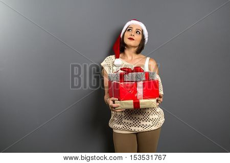 Christmas Girl Look Up Empty Copy Space Hold Gift Box Present, Young Happy Smile Woman Wear Santa Cl