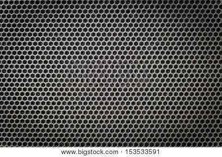 Steel grating black background with hexagonal holes.