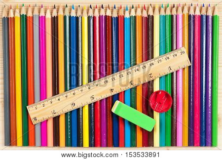 Line from color pencils for drawing over wooden surface