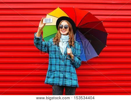 Fashion Pretty Young Smiling Woman With Colorful Umbrella Taking Picture Self Portrait On Smartphone