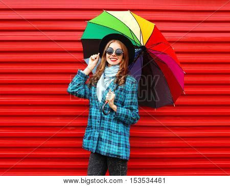 Fashion Pretty Young Smiling Woman With Colorful Umbrella Wearing A Black Hat Coat Jacket Over Red B