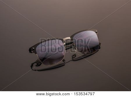 Sunglasses on dark background. Polaroid unisex sunglasses
