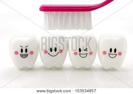 Toy teeth in a smiling mood isolated on white background with clipping path