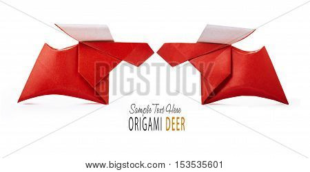 Origami paper red winter christmas running deers couple on a white background
