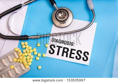 Stress Word Written On Medical Blue Folder With Patient Files