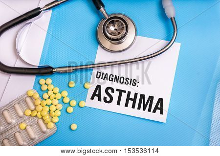 Asthma Word Written On Medical Blue Folder With Patient Files