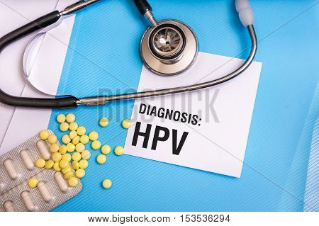 Hpv Word Written On Medical Blue Folder With Patient Files