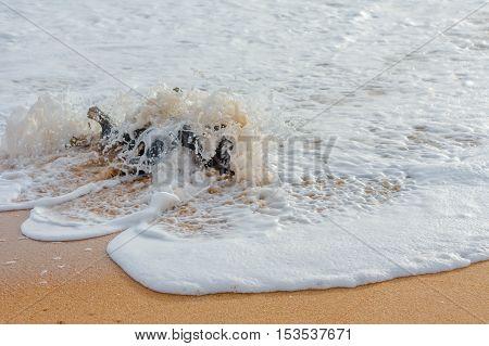 Sri Lankan beach, wave hits the object