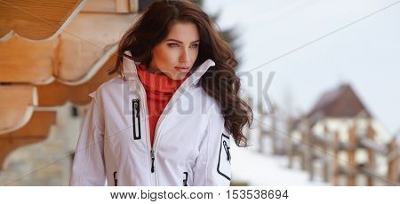 Woman snowboarder. winter day. Beautiful girl on snowbord in the snow.
