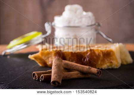 Few Pieces Of Dry Cinnamon In Front Of Apple Strudel