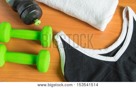 Dumbbells, towel, water bottle t-shirt. The view from the top.
