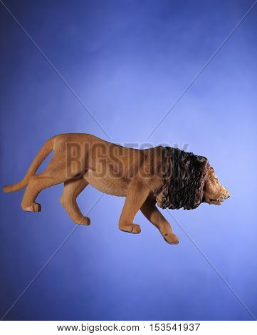 African Lion Toy Isolated On Blue