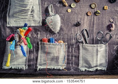 Handmade Sewing Cloth Made Of Buttons, Needles And Threads In Tailor Workshop