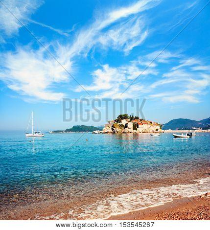 Sveti Stefan Island in Montenegro. Balkans, Adriatic Sea. European Summer Travel. Popular Touristic Mediterranean Resort. Toned Photo with Copy Space.