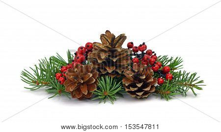 A cute little Christmas composition of natural materials: fir tree pine cone decorative red berries / isolation on a white background /. Elements of the festive decor.Close-up.