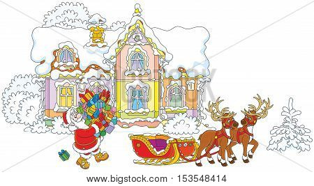 Santa Claus carrying a pile of Christmas presents to a sleigh with reindeers against the background of his house