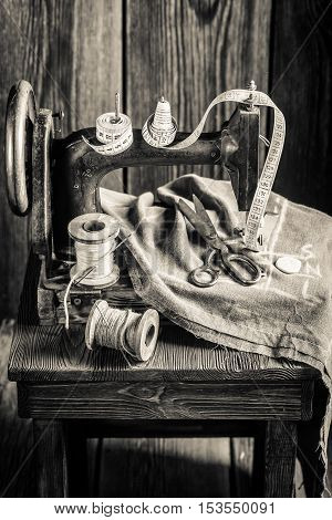 Old Tailor Machine With Scissors, Cloth And Threads