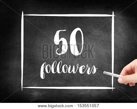 50 followers written on a blackboard