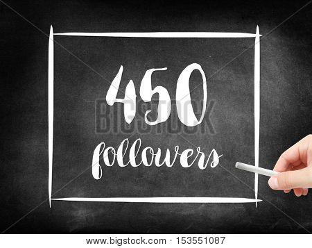 450 followers written on a blackboard