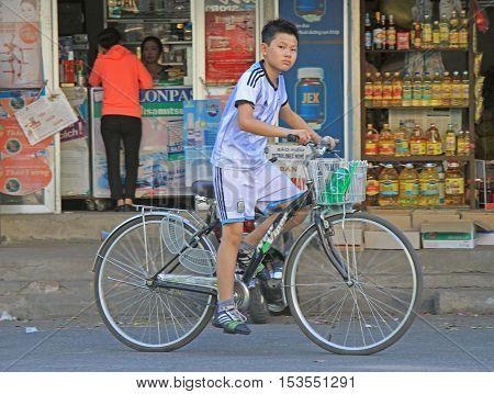 Vinh, Vietnam - May 29, 2015: boy is riding a bike outdoor in Vihn, Vietnam