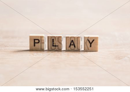 Alphabet letters on wooden pieces collected to word play