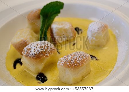 Tasty Viennese cuisine on a plate garnished with vanilla sauce