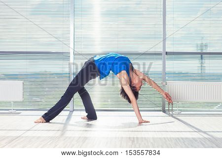 fitness, sport, training and people concept - smiling woman doing abdominal exercises on mat in gym.