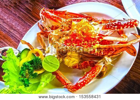 Crab with lime on a white plate